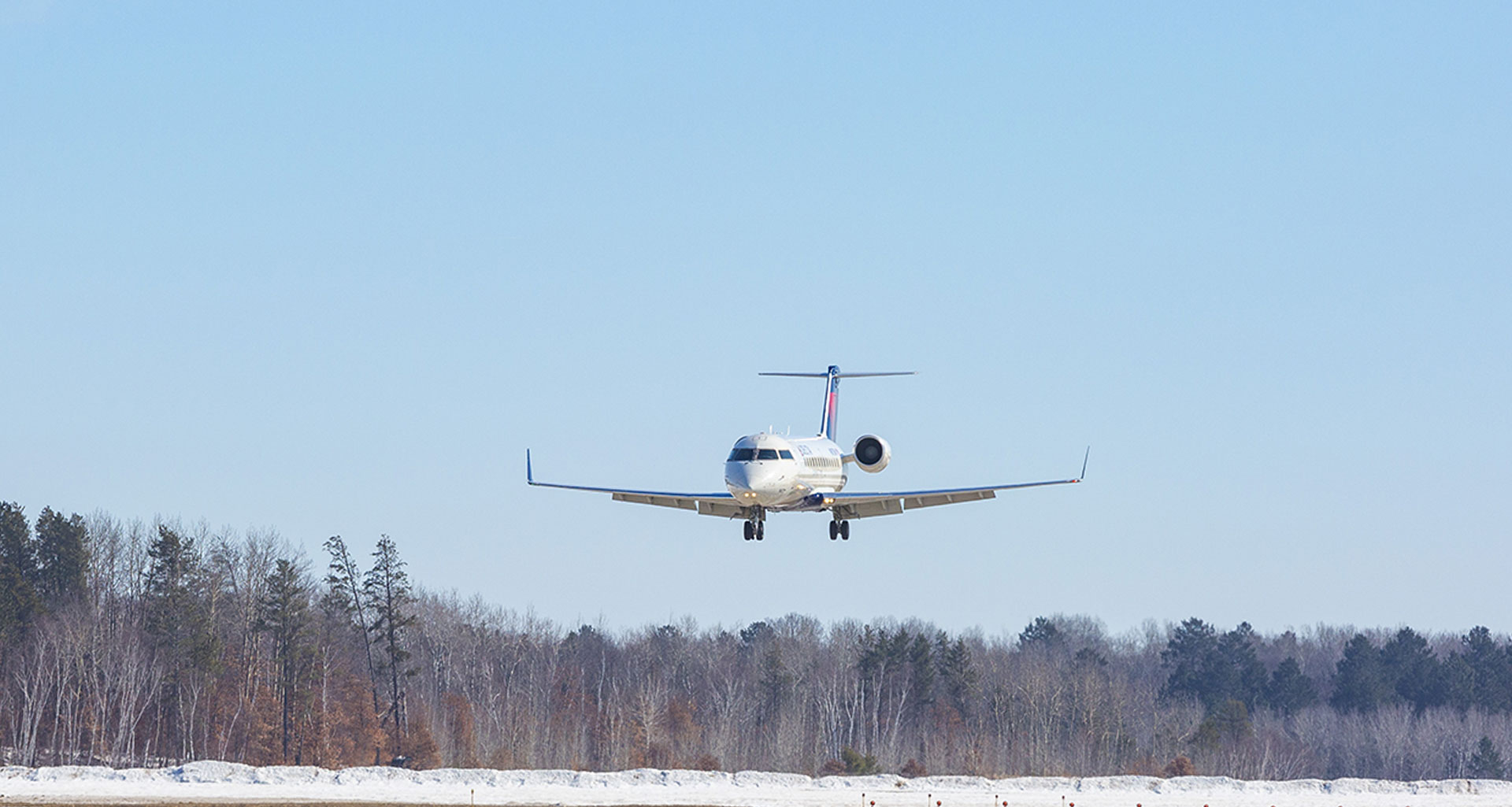 Delta jet approaching the runway for landing.