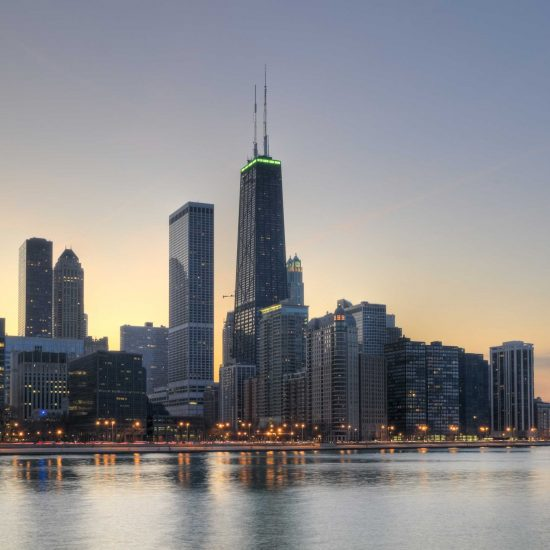 The north end of the Chicago lakefront skyline at sunset.