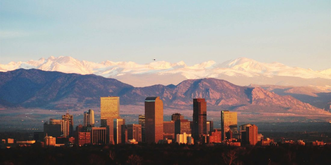 Denver, Colorado city skyline at sunset.
