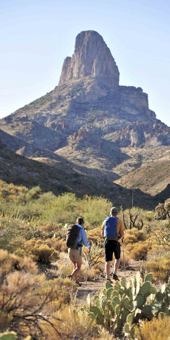 Two backpackers hiking in the Arizona desert.