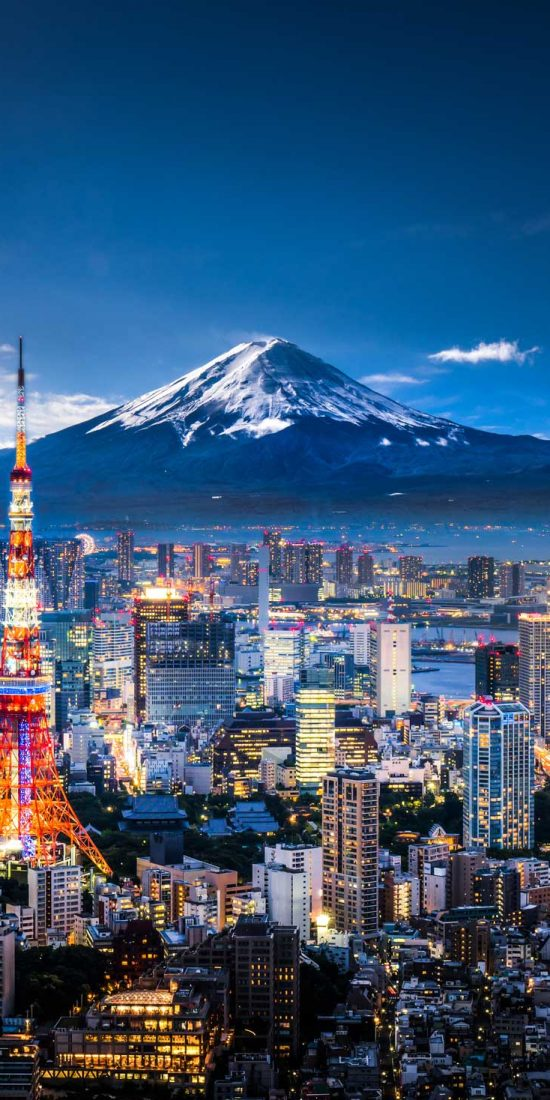 Mt. Fuji and Tokyo, Japan, city skyline at dusk