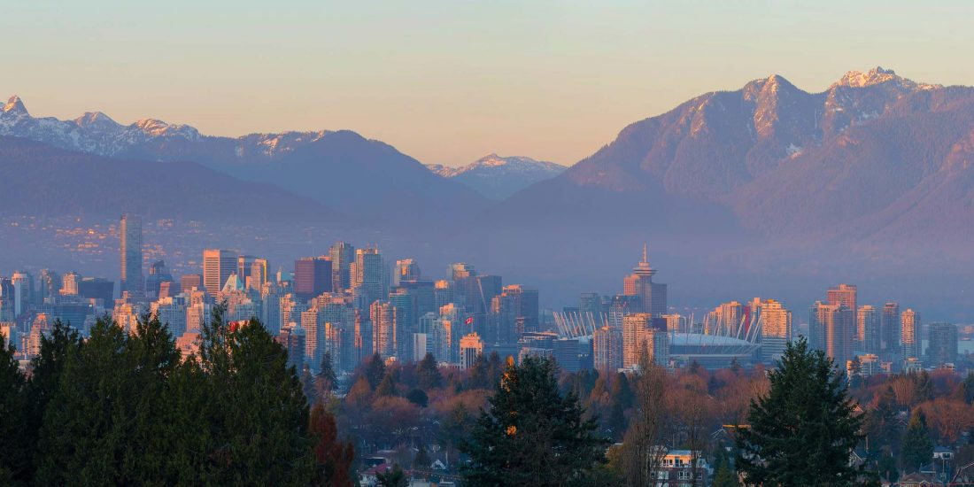 Vancouver, British Columbia, Canada city skyline and mountain view during sunset