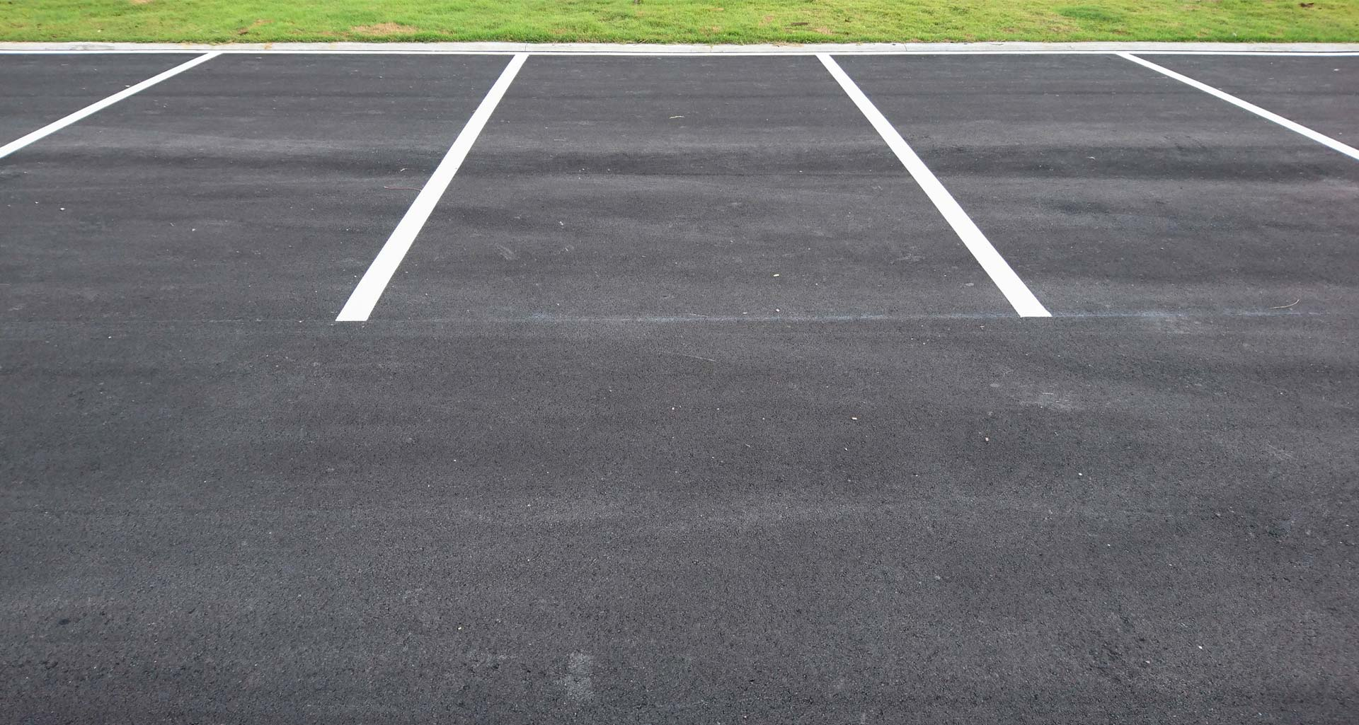 A row of empty parking spaces.
